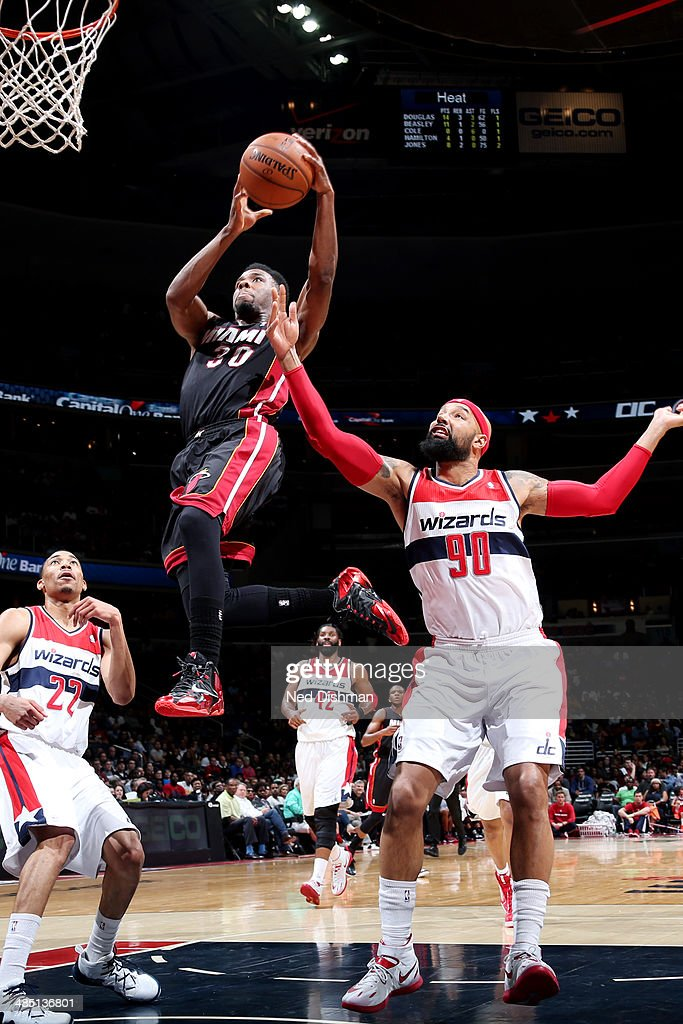 <a gi-track='captionPersonalityLinkClicked' href=/galleries/search?phrase=Norris+Cole&family=editorial&specificpeople=5770147 ng-click='$event.stopPropagation()'>Norris Cole</a> #30 of the Miami Heat shoots against the Washington Wizards at the Verizon Center on April 14, 2014 in Washington, DC.