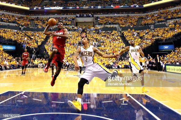 Norris Cole of the Miami Heat shoots the ball against George Hill of the Indiana Pacers in Game Six of the Eastern Conference Finals during the 2013...