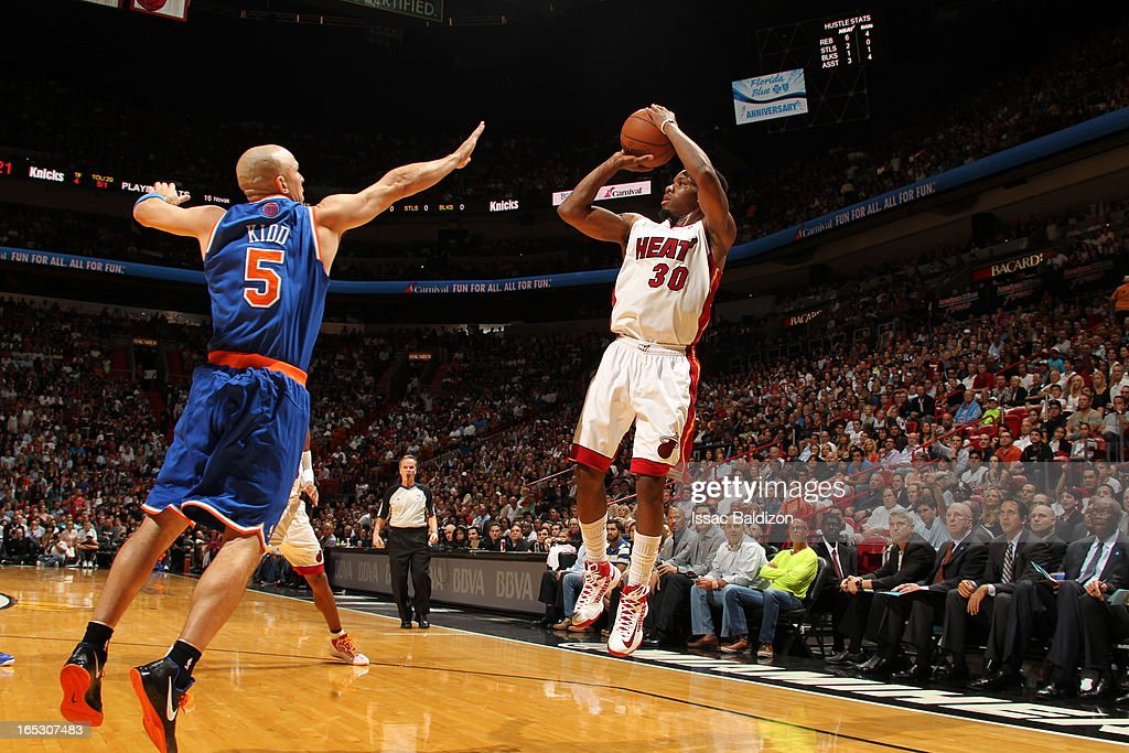 Norris Cole #30 of the Miami Heat shoots the ball against Jason Kidd #5 of the New York Knicks during a game on April 2, 2013 at American Airlines Arena in Miami, Florida.