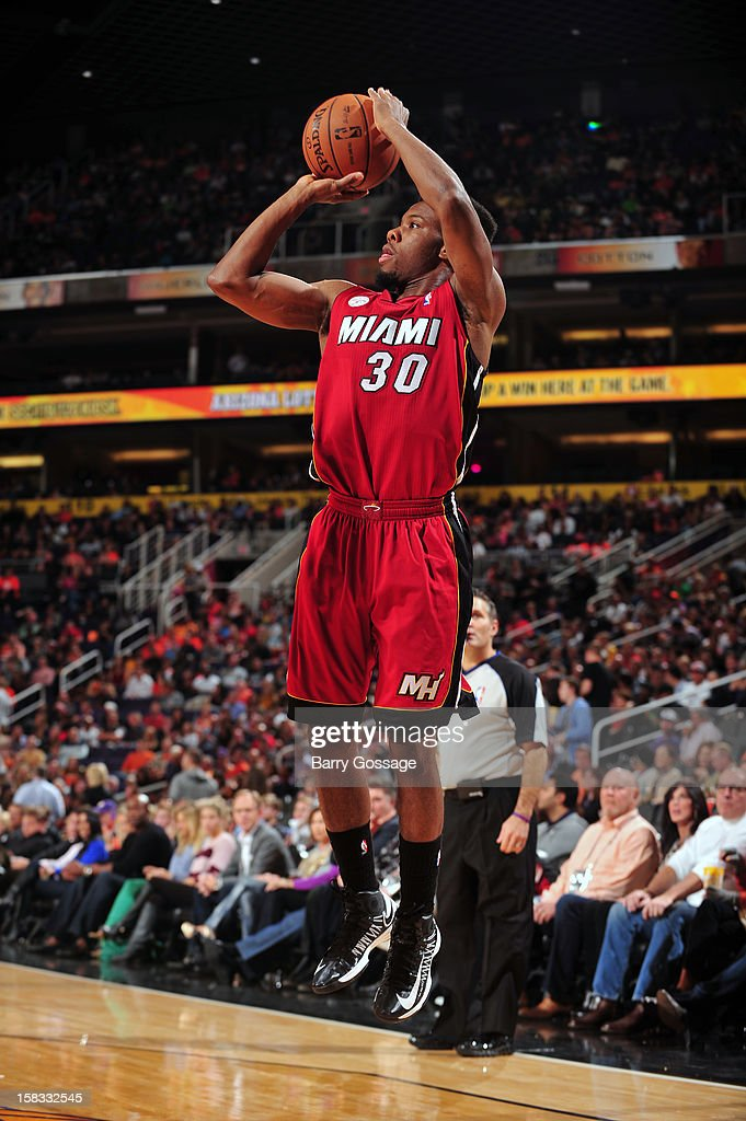 <a gi-track='captionPersonalityLinkClicked' href=/galleries/search?phrase=Norris+Cole&family=editorial&specificpeople=5770147 ng-click='$event.stopPropagation()'>Norris Cole</a> #30 of the Miami Heat takes a shot against the Phoenix Suns on November 17, 2012 at U.S. Airways Center in Phoenix, Arizona.