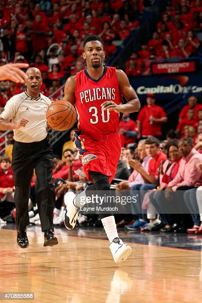 Norris Cole of the New Orleans Pelicans drives against the Golden State Warriors in Game Three of the Western Conference Quarterfinals during the NBA...