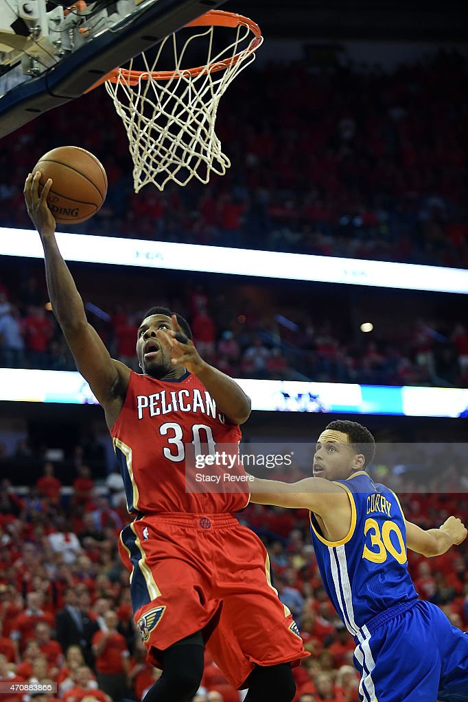 Norris Cole of the New Orleans Pelicans drives to the basket against Stephen Curry of the Golden State Warriors during the first half of Game Three...