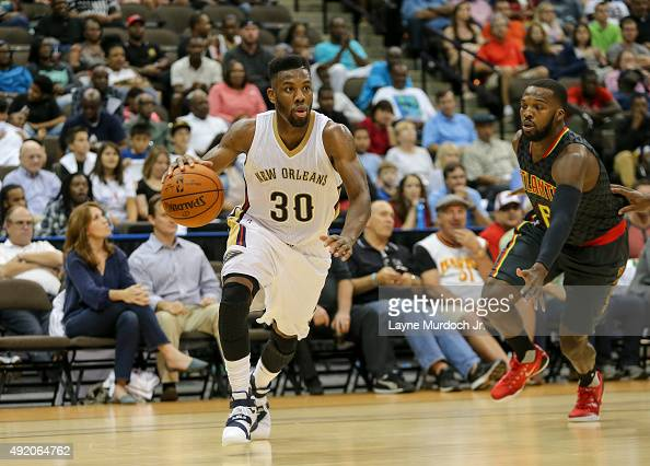 Norris Cole of the New Orleans Pelicans handles the ball against the Atlanta Hawks during a preseason game on October 9 2015 at the Jacksonville...