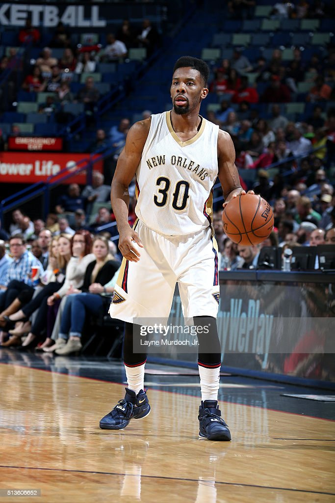 Norris Cole of the New Orleans Pelicans handles the ball during the game against the San Antonio Spurs on March 3 2016 at the Smoothie King Center in...