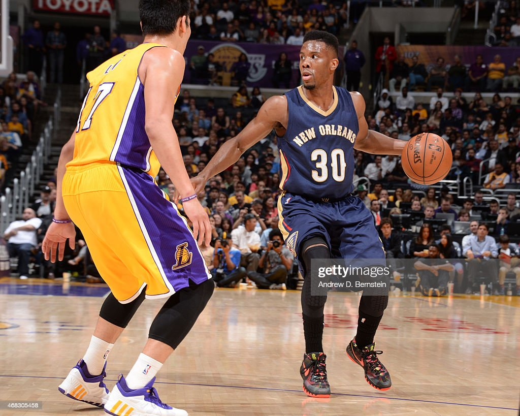 Norris Cole of the New Orleans Pelicans looks to move the ball against the Los Angeles Lakers during the game at STAPLES Center on April 1 2015 in...