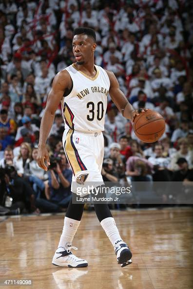 Norris Cole of the New Orleans Pelicans looks to move the ball against the Golden State Warriors during Game Four of the Western Conference...