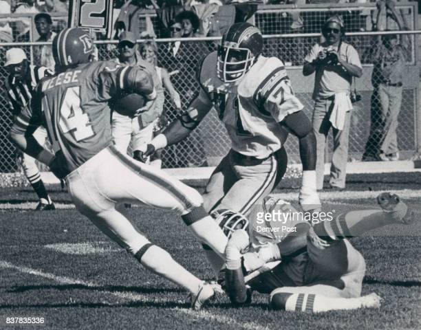 Norris Weese of the Broncos evades Woodrow Lowe and Fred Dean of the Chargers Credit The Denver Post