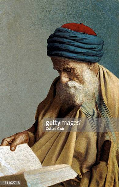 North African Rabbi studying reading from a Hebrew book Wearing Arab style headgear and clothing
