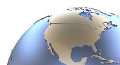 North America on metallic model of planet Earth with embossed continents and visible country borders. 3D rendering.