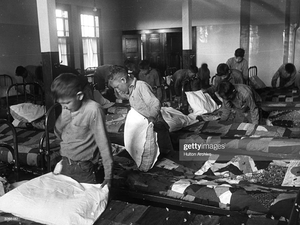 North American Indian children in their dormitory at a Canadian boarding school