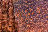 Close up of Sinaguan petroglyphs with modern graffiti in background