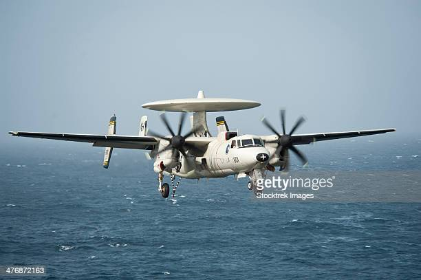 North Arabian Sea, July 22, 2013 - An E-2C Hawkeye prepares to land on the flight deck of the aircraft carrier USS Nimitz.