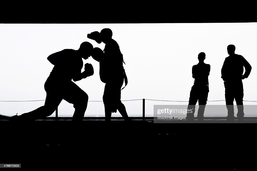 North Arabian Sea, July 23, 2013 - Aviation Boatswain's Mates practice boxing in the hangar bay aboard the aircraft carrier USS Nimitz.