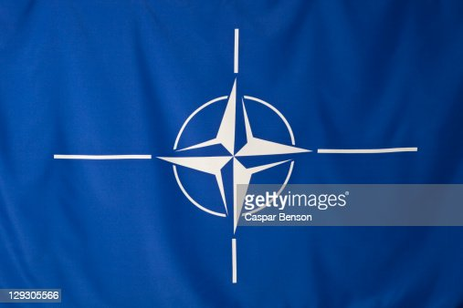 North Atlantic Treaty Organization flag, white compass rose emblem in blue background : Stock Photo