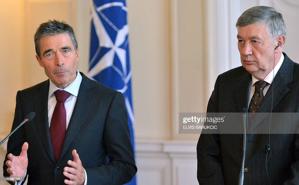 North Atlantic Treaty Organization (NATO) Secretary-General Anders Fogh Rasmussen (L) gives a press conference on February 7, 2013 after meeting with members of Bosnia and Herzegovina's tripartite presidency, including Nebojsa Radmanovic (R), in Sarajevo at the start of his one-day, official visit to Bosnia. AFP PHOTO / ELVIS BARUKCIC