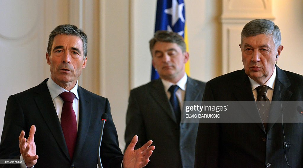 North Atlantic Treaty Organization (NATO) Secretary-General Anders Fogh Rasmussen (L) gives a press conference on February 7, 2013 after meeting with members of Bosnia and Herzegovina's tripartite presidency, Nebojsa Radmanovic (R) and Zeljko Komsic (C), in Sarajevo at the start of his one-day, official visit to Bosnia.