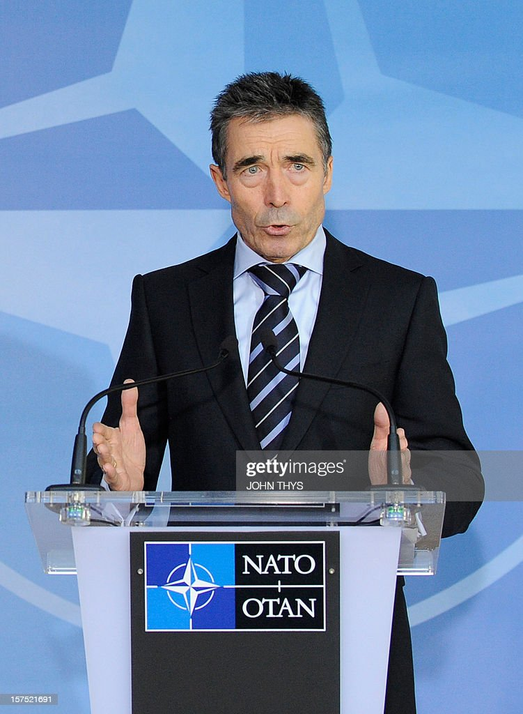 North Atlantic Treaty Organization (NATO) Secretary-General Anders Fogh Rasmussen speaks on December 4, 2012 at a meeting of foreign ministers from the 28 NATO member-countries at organization headquarters in Brussels on Syria and Turkey's request for Patriot missiles to be deployed protectively on the Turkish-Syrian border. AFP PHOTO / JOHN THYS