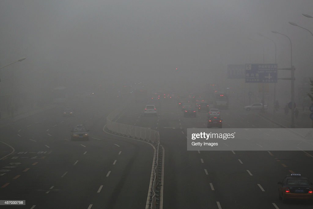 North Avenue of Zhongguancun is surrounded by heavy smog on October 11 2014 in Beijing China Beijing City Meteorological Center issued an orange...