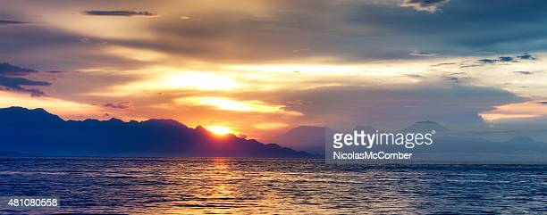 North Bali coast and ocean at sunset with fishermen panorama