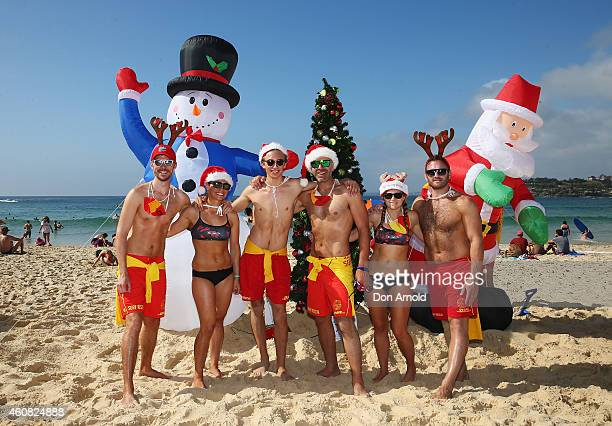 North Bondi surfclub lifesavers pose in front of their Christmas decorations at Bondi Beach on December 25 2014 in Sydney Australia Bondi Beach is a...
