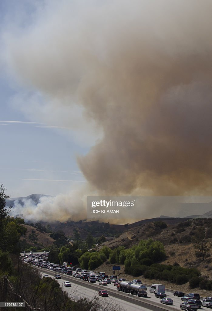 North bound traffic in full stop due to a brush fire near Highway 101 and Calabasas on August 18 2013 north of Los Angeles California A car fire...