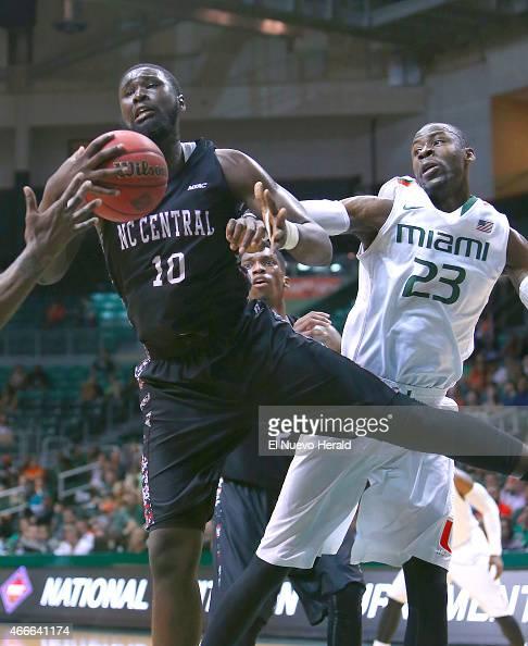 North Carolina Central's Karamo Jawara grabs a rebound against Miami's Tonye Jekiri during the first half of National Invitation Tournament...