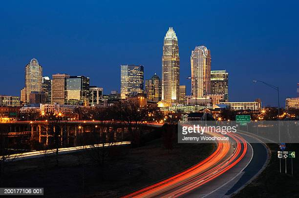 USA, North Carolina, Charlotte, city skyline and highway, dawn