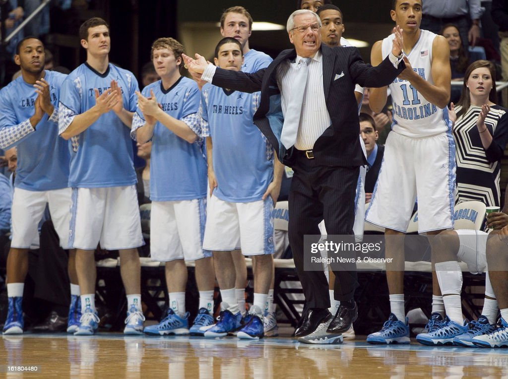 North Carolina coach Roy Williams leaps in front of the bench as the Tar Heels try to maintain their lead over Virginia during the closing seconds of the first half at the Smith Center in Chapel Hill, North Carolina, Saturday February 16, 2013. UNC beat Virginia, 93-81.