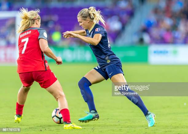 North Carolina Courage defender Stephanie Ochs passes Portland Thorns FC midfielder Lindsey Horan during the NWSL soccer Championship match between...