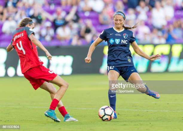 North Carolina Courage forward Ashley Hatch shoots past Portland Thorns FC defender Emily Menges during the NWSL soccer Championship match between...