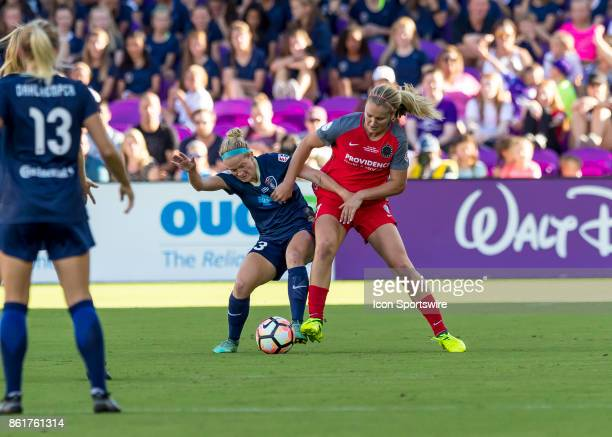 North Carolina Courage forward Makenzy Doniak challenges Portland Thorns FC midfielder Lindsey Horan for possession during the NWSL soccer...