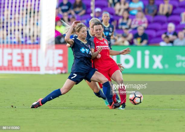North Carolina Courage midfielder McCall Zerboni challenges Portland Thorns FC forward Hayley Raso during the NWSL soccer Championship match between...
