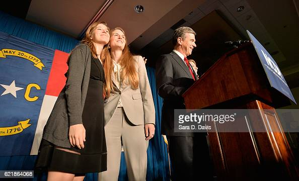 North Carolina Democratic Gubernatorial nominee Roy Cooper speaks to a crowd with his family at the North Carolina Democratic Watch Party on November...