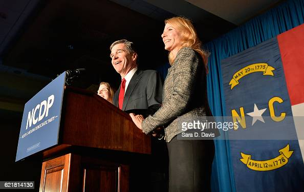 North Carolina Democratic presumptive Governor elect Roy Cooper speaks to a crowd alongside his wife Kristin at the North Carolina Democratic Watch...