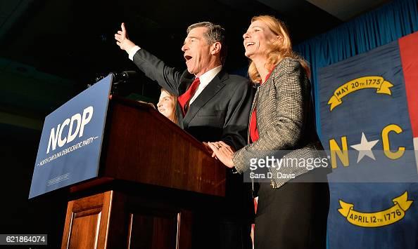 North Carolina Democratic presumptive Governor elect Roy Cooper waves to a crowd alongside his wife Kristin Cooper at the North Carolina Democratic...