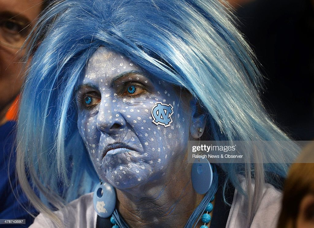 North Carolina fan Annette Wood, of Rural Hall, N.C., sits and watches as the Tar Heels fall behind by double digits in the second half against Pittsburgh in the quarterfinals of the ACC Tournament on Friday, March 14, 2014, in Greensboro, N.C. Pitt advanced, 80-75.