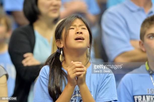 North Carolina fan reacts to the team arriving for their welcomehome reception for the NCAA men's basketball team on April 4 2017 in Chapel Hill...