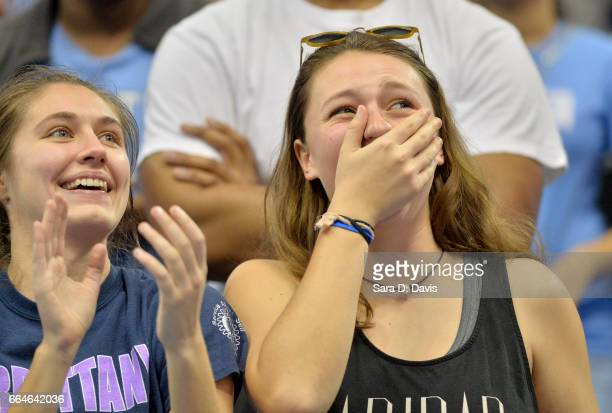 North Carolina fans react to the team arriving for their welcomehome reception for the NCAA men's basketball team on April 4 2017 in Chapel Hill...