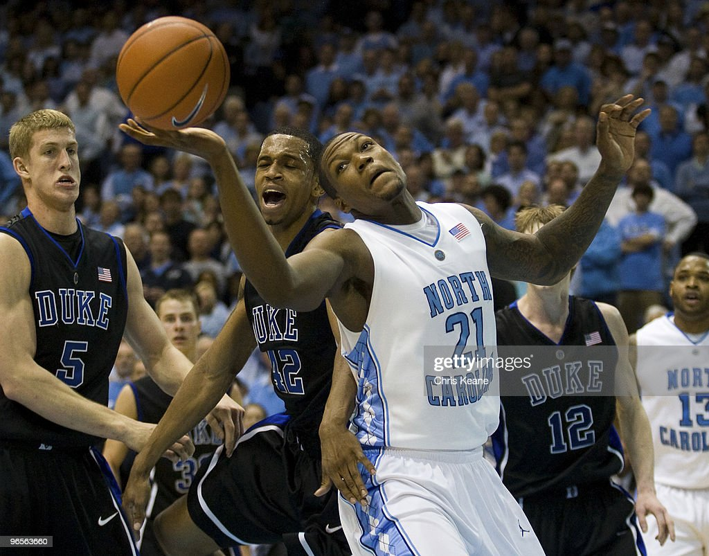 North Carolina forward <a gi-track='captionPersonalityLinkClicked' href=/galleries/search?phrase=Deon+Thompson&family=editorial&specificpeople=4026290 ng-click='$event.stopPropagation()'>Deon Thompson</a> #21 fights for a rebound against Duke forward <a gi-track='captionPersonalityLinkClicked' href=/galleries/search?phrase=Lance+Thomas&family=editorial&specificpeople=3847256 ng-click='$event.stopPropagation()'>Lance Thomas</a> (42) during a men's college basketball game at Dean Smith Center on February 10, 2010 in Chapel Hill, North Carolina.