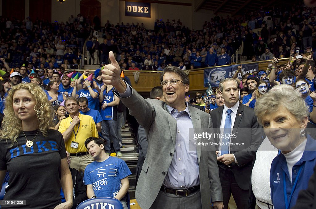 North Carolina Governor Pat McCrory waves to television analyst Mike Gminski as he arrives at Cameron Indoor Stadium in Durham, North Carolina, for the Duke vs. North Carolina clash on Wednesday, February 13, 2013.