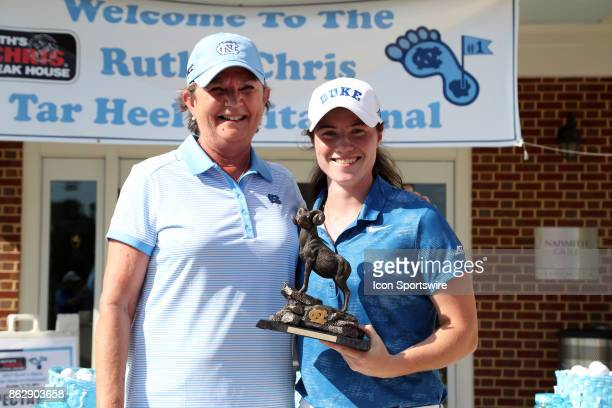 North Carolina head coach Jan Mann presents a trophy to Duke's Leona Maguire for winning the individual title during the third and final round of the...