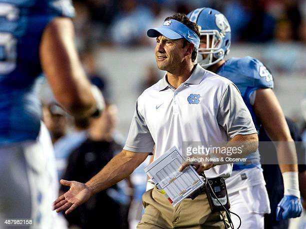 North Carolina head coach Larry Fedora congratulates his offensive unit after scoring a touchdown in the second quarter against North Carolina AT on...