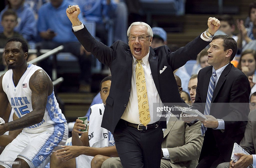 North Carolina head coach Roy Williams celebrates after a fast-break basket by James Michael McAdoo following a defensive steal against East Tennessee State at the Smith Center in Chapel Hill, North Carolina, on Saturday, December 8, 2012. The host Tar Heels won, 78-55.