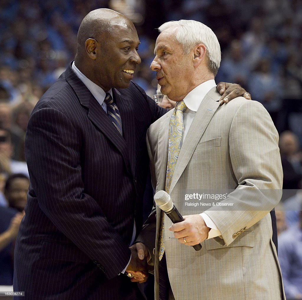 North Carolina head coach Roy Williams,r ight, embraces former Tar Heels great Phil Ford during halftime of the Tar Heels' game against Florida State at the Smith Center in Chapel Hill, North Carolina, Sunday, March 3, 2013. UNC defeated Florida State, 79-58.
