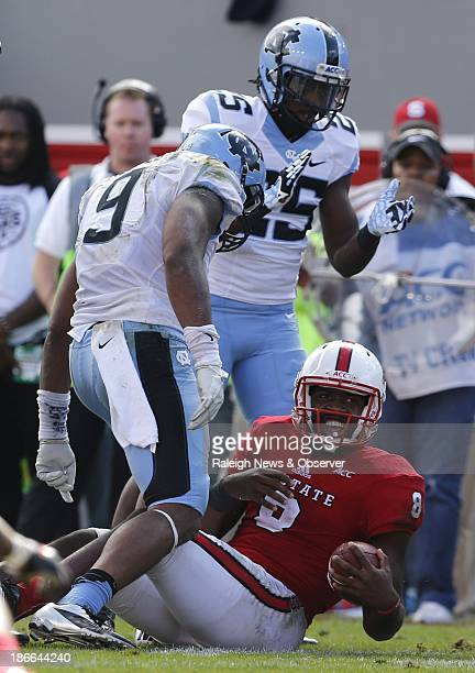 North Carolina linebacker Travis Hughes and North Carolina cornerback Kameron Jackson celebrate after stopping NC State quarterback Brandon Mitchell...