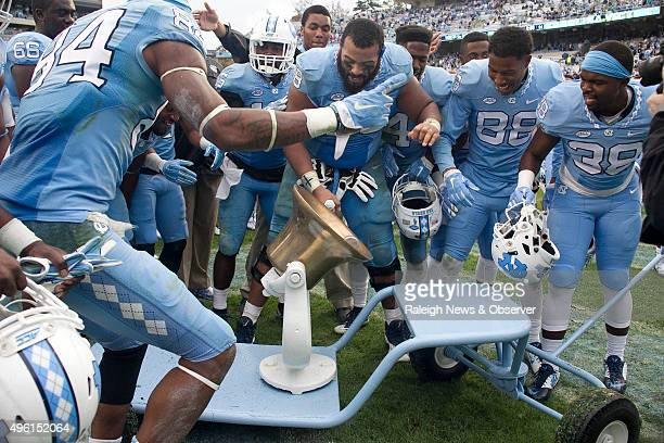North Carolina senior Landon Turner takes a turn with the victory bell as he celebrates with his teammates following the Tar Heels' 6631 victory...