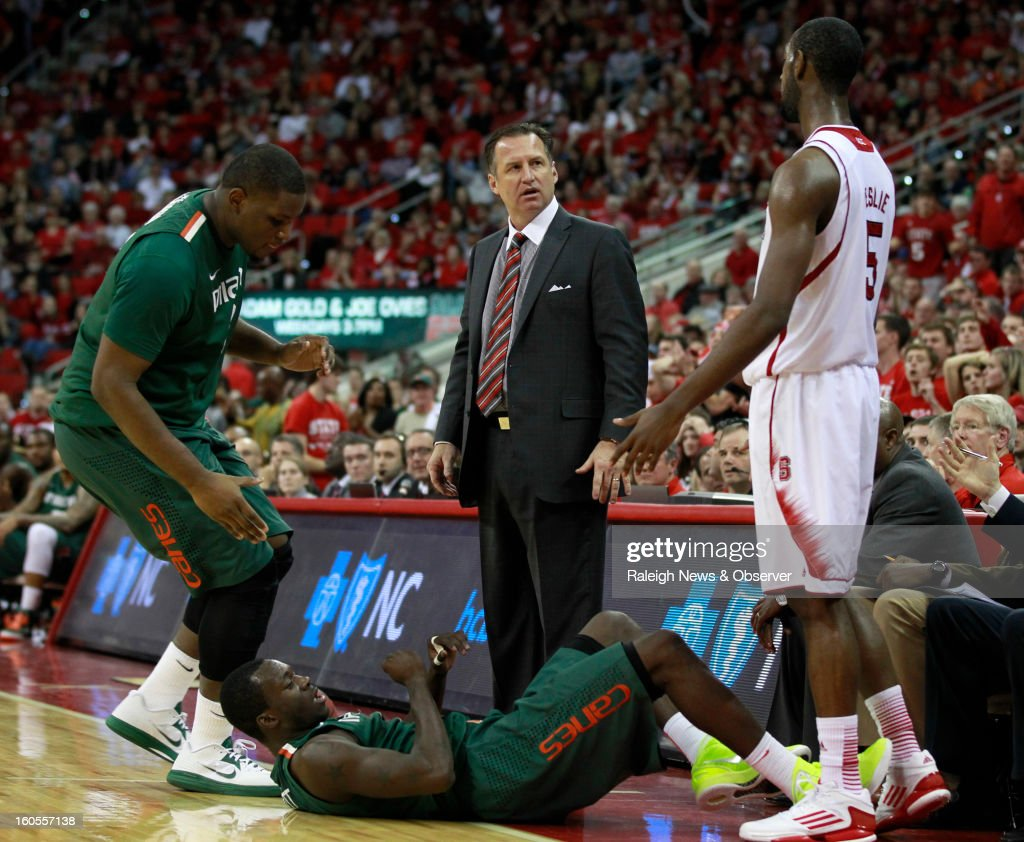North Carolina State coach Mark Gottfried looks at C.J. Leslie (5) after Leslie fouled Miami's Durand Scott, who is on the floor, with 45 seconds left in Miami's 79-78 victory at PNC Arena in Raleigh, North Carolina, on Saturday, February 2, 2013.