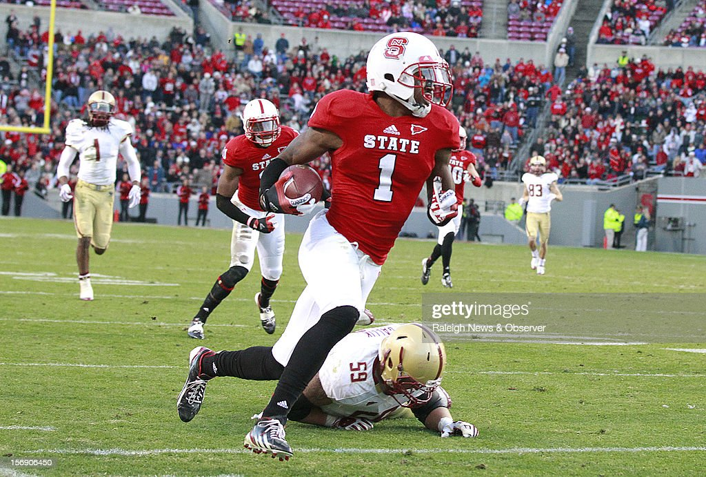 North Carolina State cornerback David Amerson (1) beats Boston College center Andy Gallik (59) as he takes an interception in for a touchdown during the first half on Saturday, November 24, 2012, at Carter-Finley Stadium in Raleigh, North Carolina.