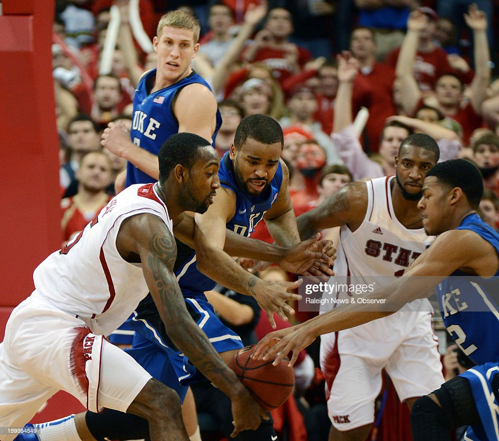 North Carolina State forward C.J. Leslie (5) battles for a loose ball with Duke forward Josh Hairston (15) and guard Quinn Cook (2) at PNC Arena in Raleigh, North Carolina, Saturday, January 12, 2013. N.C. State defeated Duke 84-76.