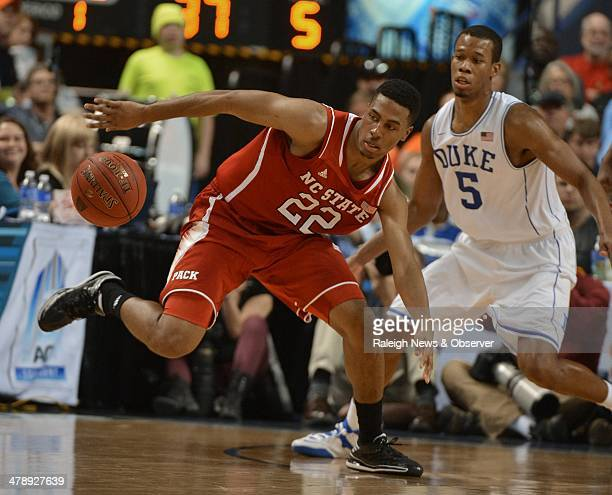 North Carolina State guard Ralston Turner looses the handle on the ball as Duke forward Rodney Hood defends in the first half of a semifinal in the...